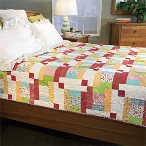 Staccato: Quick Bright Fun One-Block Bed Quilt Pattern Designed by SARAH MAXWELL & DOLORES SMITH