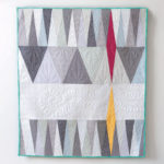 A modern quilt designed by Natalie Barnes called Scales Quilt