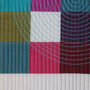 Catherine uses a heavier weight thread to quilt the spiral.