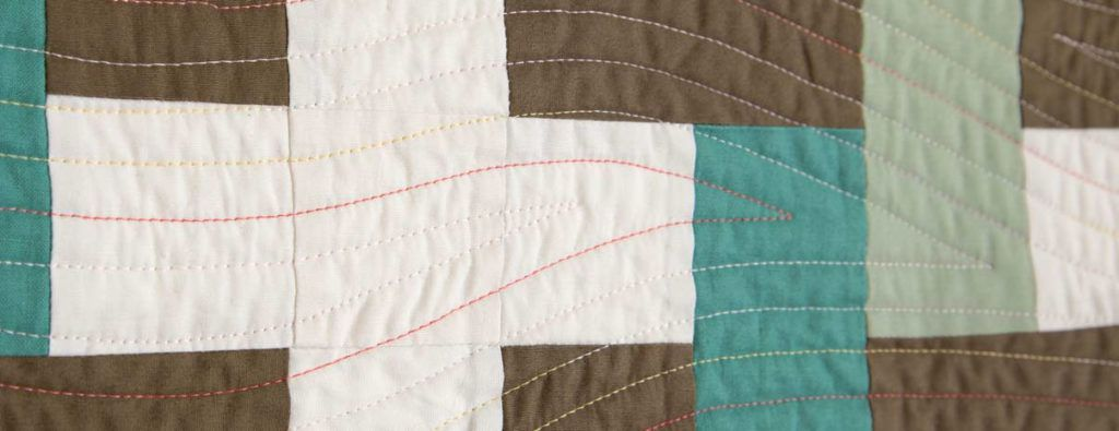 """Detail of """"Mediterranean Breezes"""" designed and walking foot quilted by Catherine Redford."""