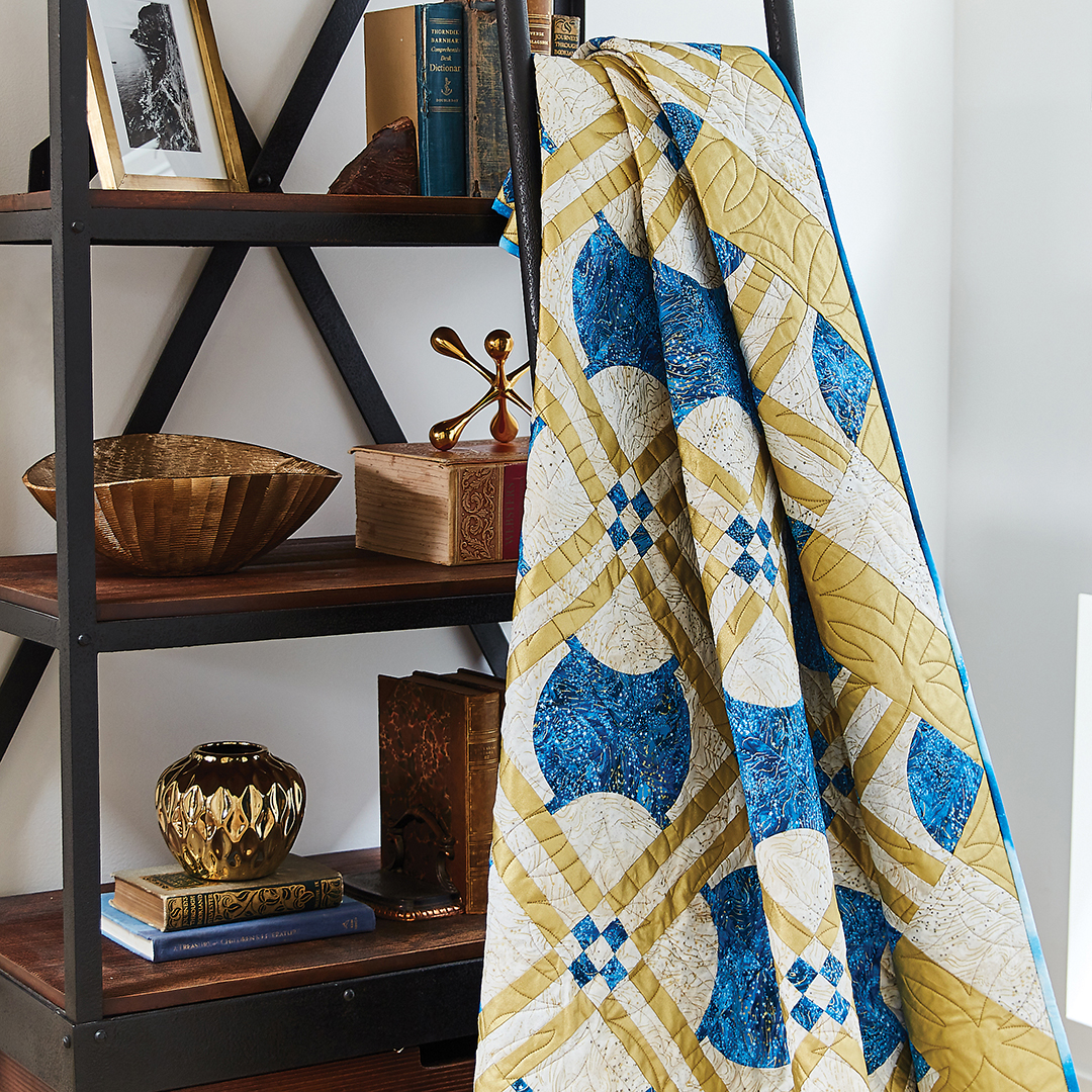 Shining gold fabric makes this quilt shimmer like the stars.