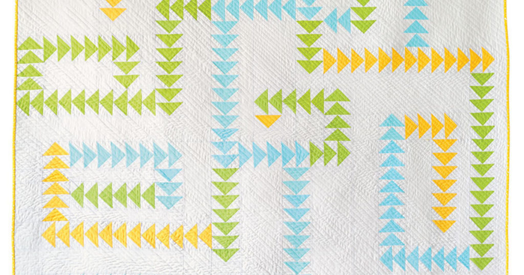 Cheery flying geese quilt perfect for summer