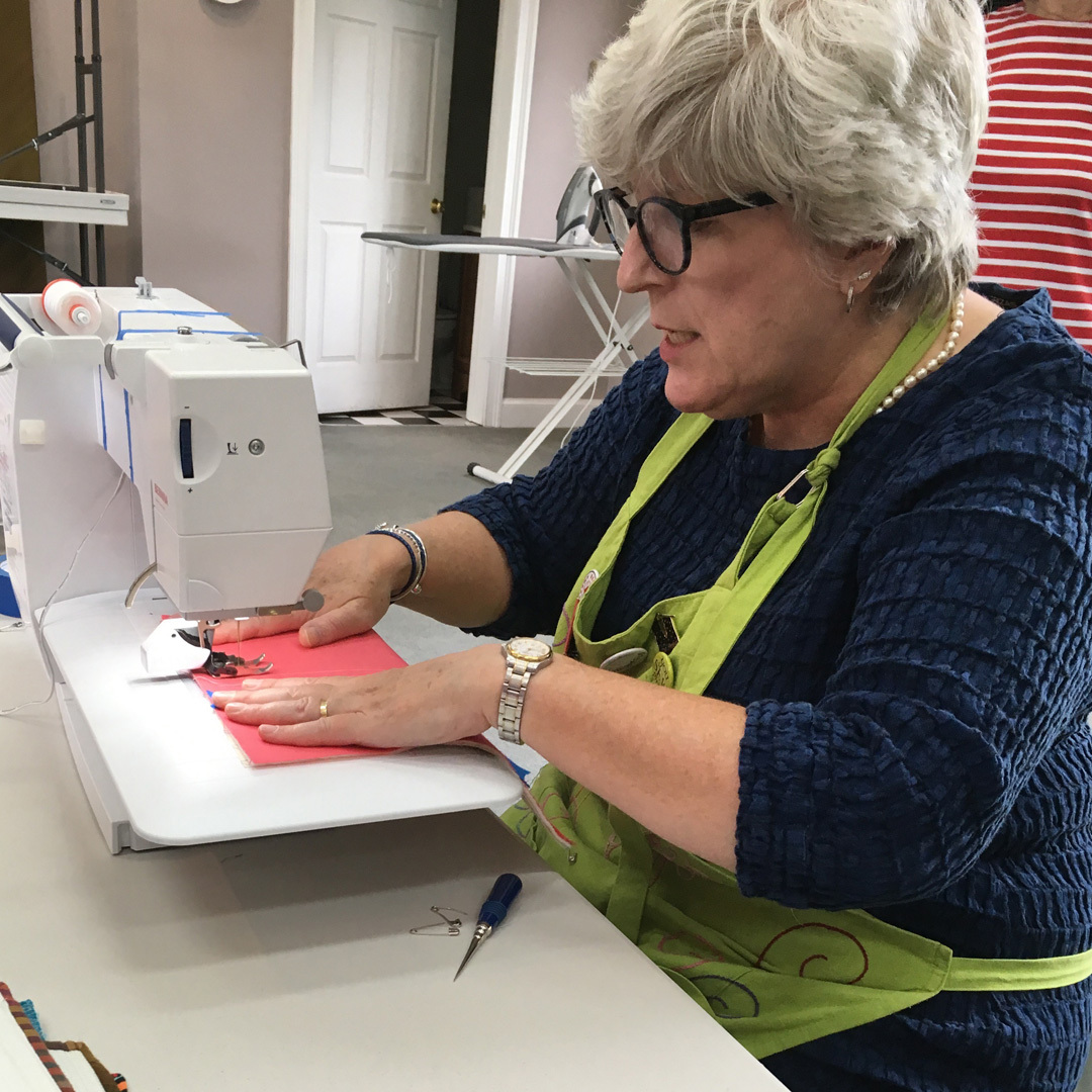 Catherine Redford demonstrates both walking foot and free-motion quilting at her classes.