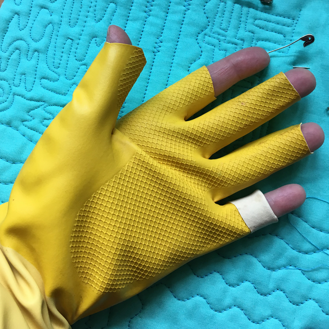Make your own quilting gloves by cutting the fingertips from common household gloves.