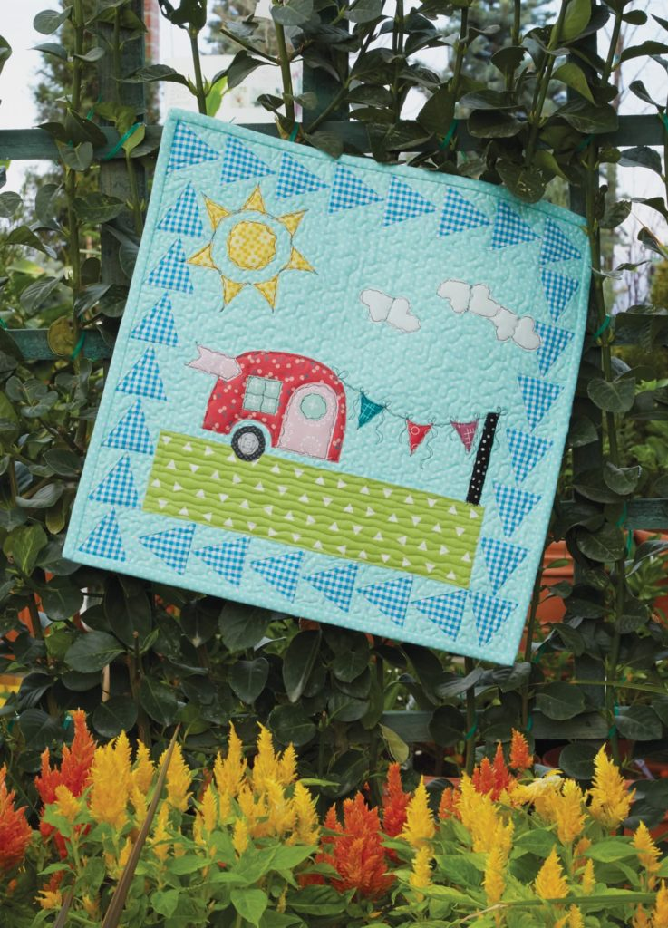 Create a petite, whimsical applique quilt, like Happy Camper.