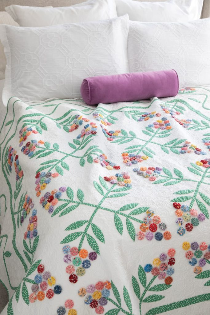 Nancy Mahoney's applique quilt yo-yo's are a delightful addition to her Cherry Surprise quilt.