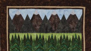 Quiltmaker July/Aug 2021 header - Shore to Peaks by Laureen Smith features 1895 Watercolors by Hoffman