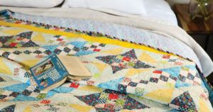 MCCalls July/Aug 21 header - quilt with book