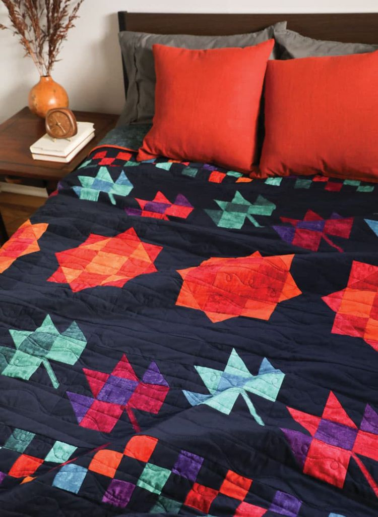Blaze Bright by Ramona Sorenson- a bold and colorful quilt in salsa colors