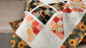 Quiltmaker Magazine Sept/Oct 2021 header image featuring Autumn Wreath quilt