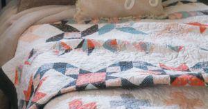 McCalls Sept/Oct header image featuring row quilt