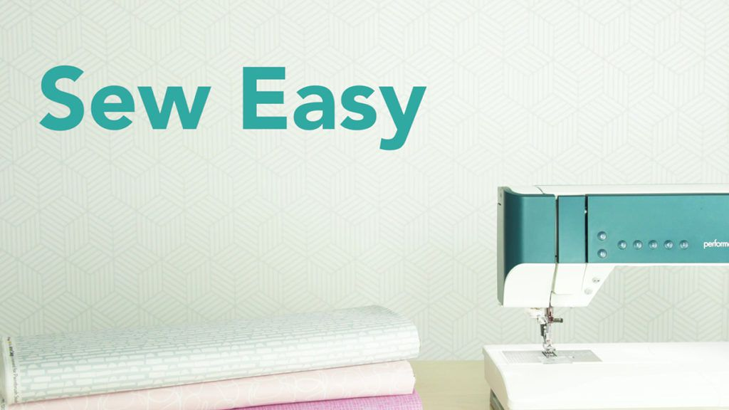 sew easy lesson header with image of a sewing machine and folded fabric