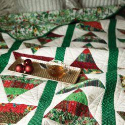 Love of Quilting Nov/Dec 2021 cover photo featuring Peggy Gelbrich's festive Tannenbaum Tumble
